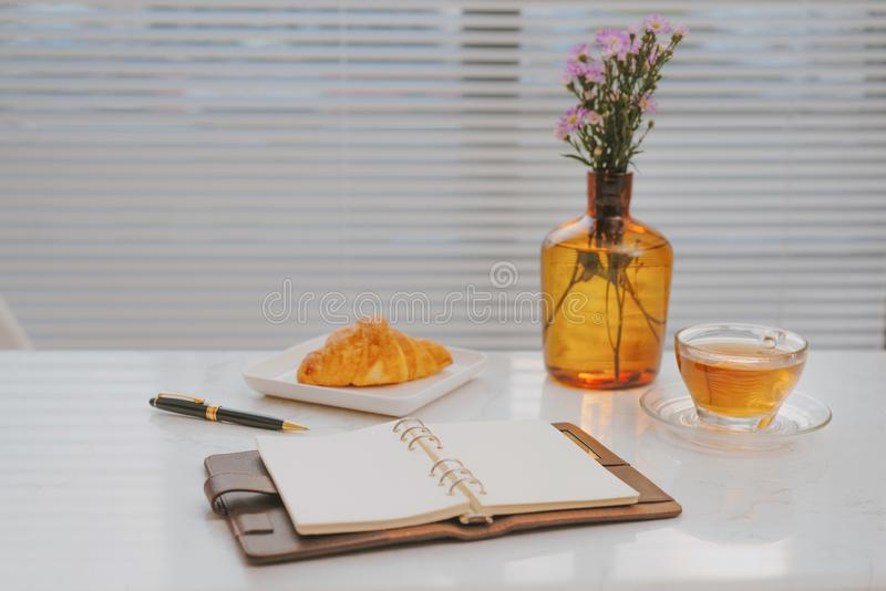 Business work on marble table coffee with croissant bakery.  stock photo