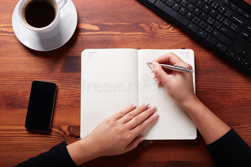 Business work place. With hands, top view stock images