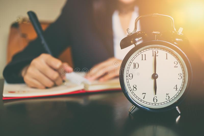 Business working time concept. morning 6 o`clock. With work people on background royalty free stock photos