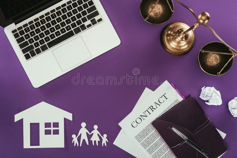 Business workplace with home and family insurance oncept on purple tabletop. Top view of business workplace with home and family insurance oncept on purple royalty free stock images