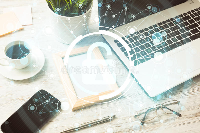 Business workplace with laptop coffee cup and security concept o. Opened laptop and other office stuff on wooden table royalty free stock images