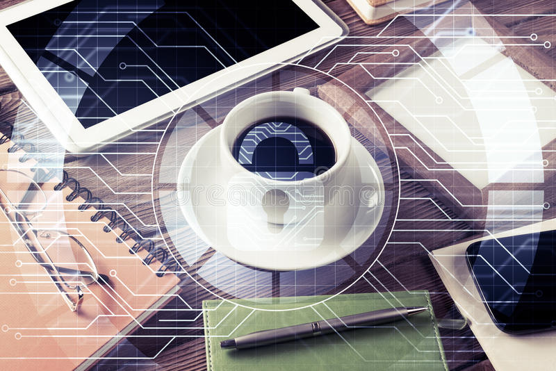 Business workplace with tablet pc and security concept on screen. Tablet coffee cup and other office stuff on wooden table stock photo
