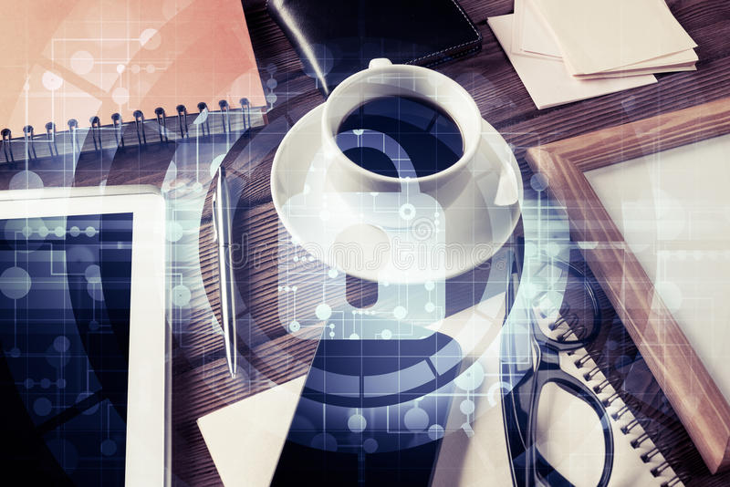 Business workplace with tablet pc and security concept on screen. Tablet coffee cup and other office stuff on wooden table royalty free stock photo