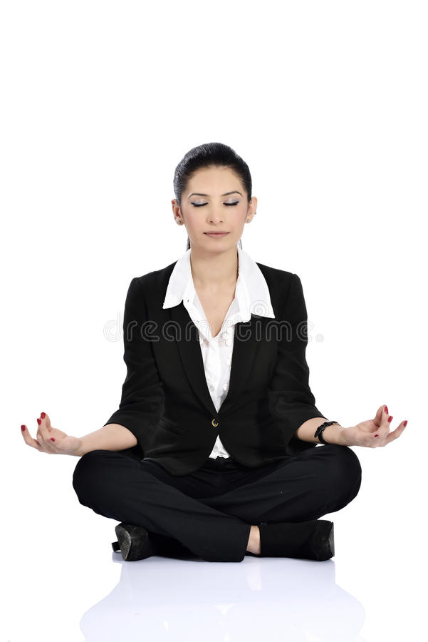 Business yoga. Business woman doing yoga isolated over a white background royalty free stock images