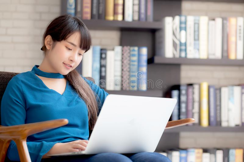 Business young asian woman freelance work on display laptop computer on chair royalty free stock images