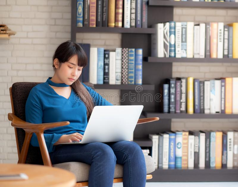 Business young asian woman freelance work on display laptop computer on chair stock images