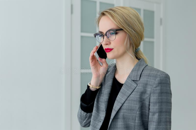 Business young beautiful woman talking on the phone royalty free stock photography