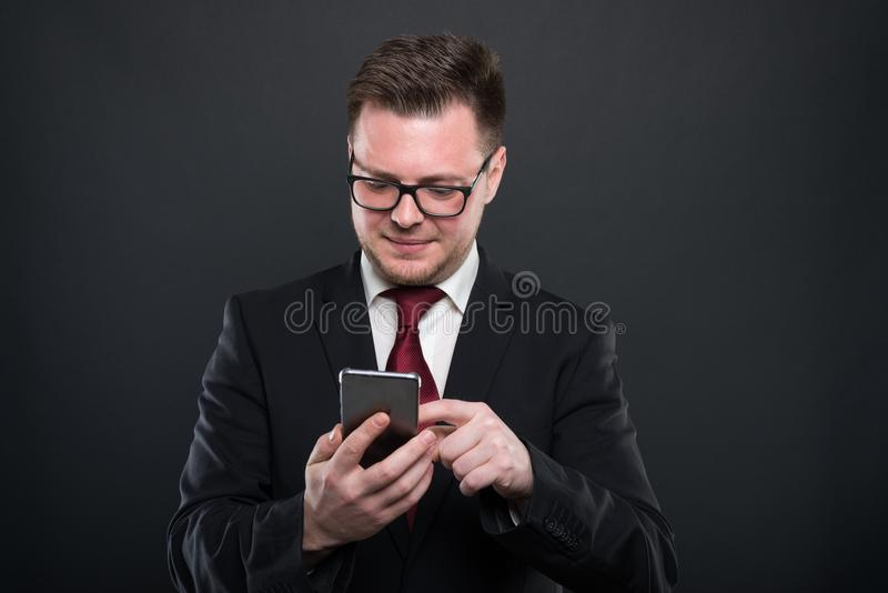 Business young man browsing on black smartphone stock photos