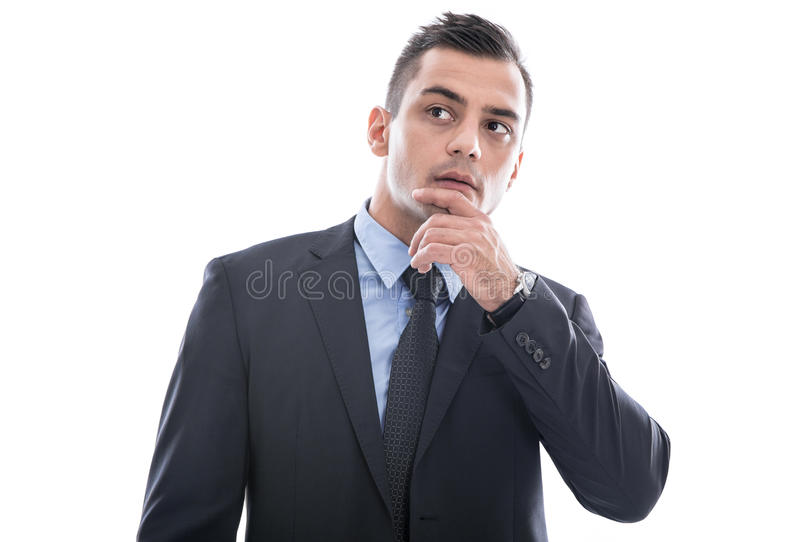 Business: young man in doubt - in suit thinking with hand touching face isolated on white background stock images