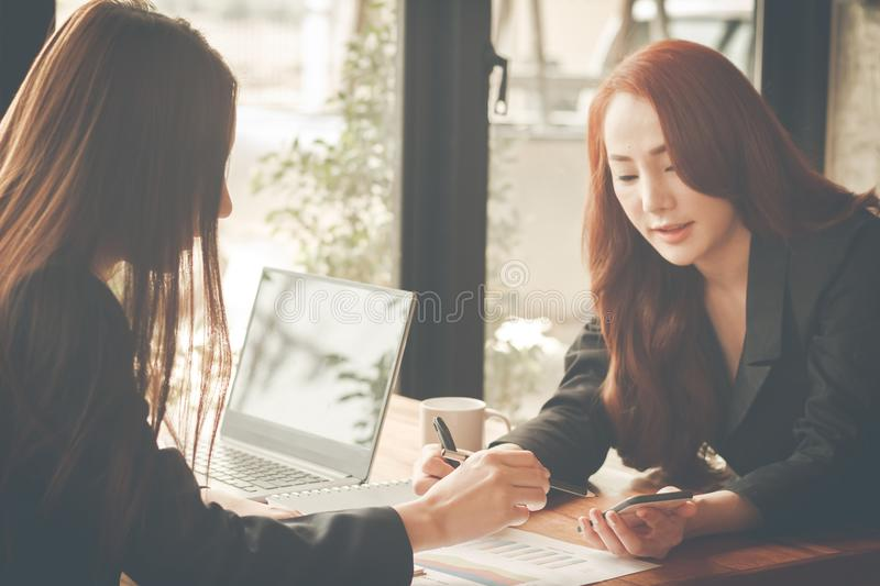 Business young woman agree to be partner,Sales manager are presenting export items to partner,Investors joint venture. Business young women agree to be partner royalty free stock photo
