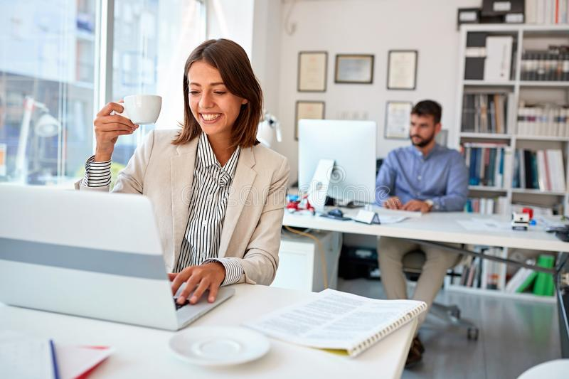 Business woman manager drink coffee at work royalty free stock photo