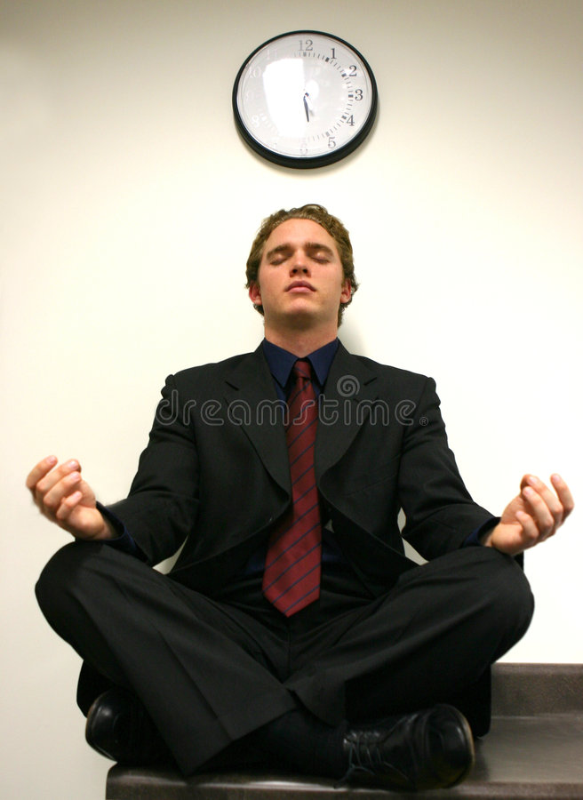 Business Zen. Business man in a zen royalty free stock image
