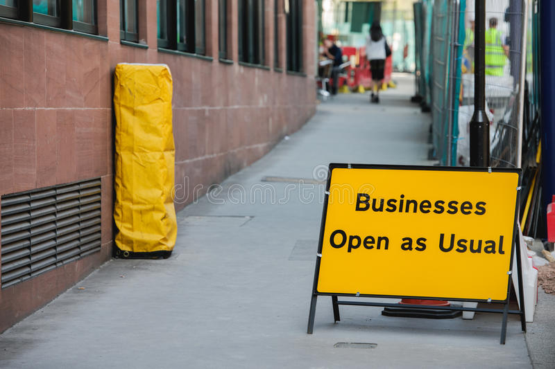 Businesses open as usual sign. During re construction of a busy public street in a capital city royalty free stock image