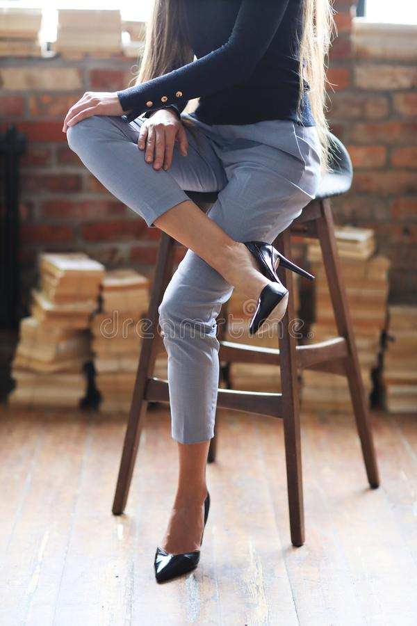 Businesslike woman. Posing on a brick wall background stock photos