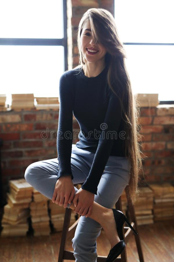 Businesslike woman. Posing on a brick wall background royalty free stock photography