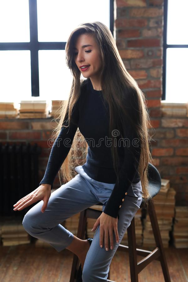 Businesslike woman. Posing on a brick wall background royalty free stock image