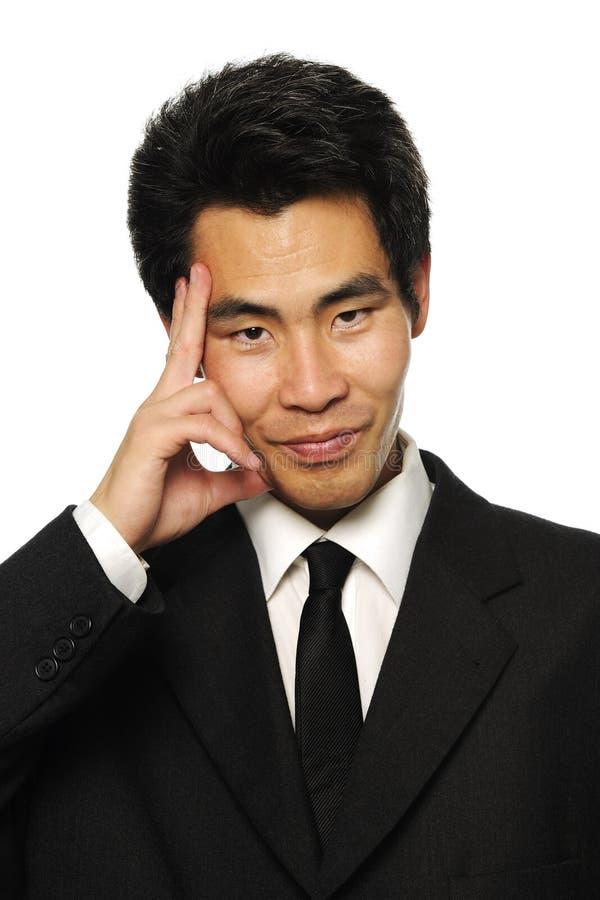 Businessma asiático que escucha fotos de archivo libres de regalías