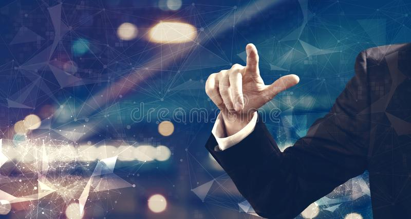 Businessma pointing something. On night city background stock images