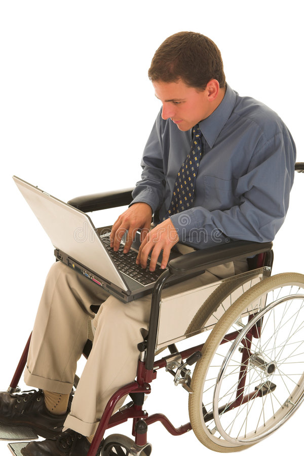 Businessman #135. Businessman working on a laptop in a wheelchair stock photos