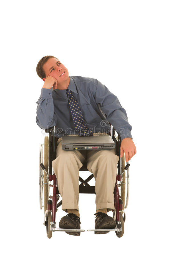 Businessman #136. Businessman sitting in a wheelchair with a laptop stock photography