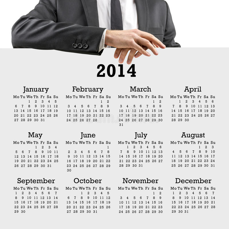 Businessman with a 2014 calendar stock photo