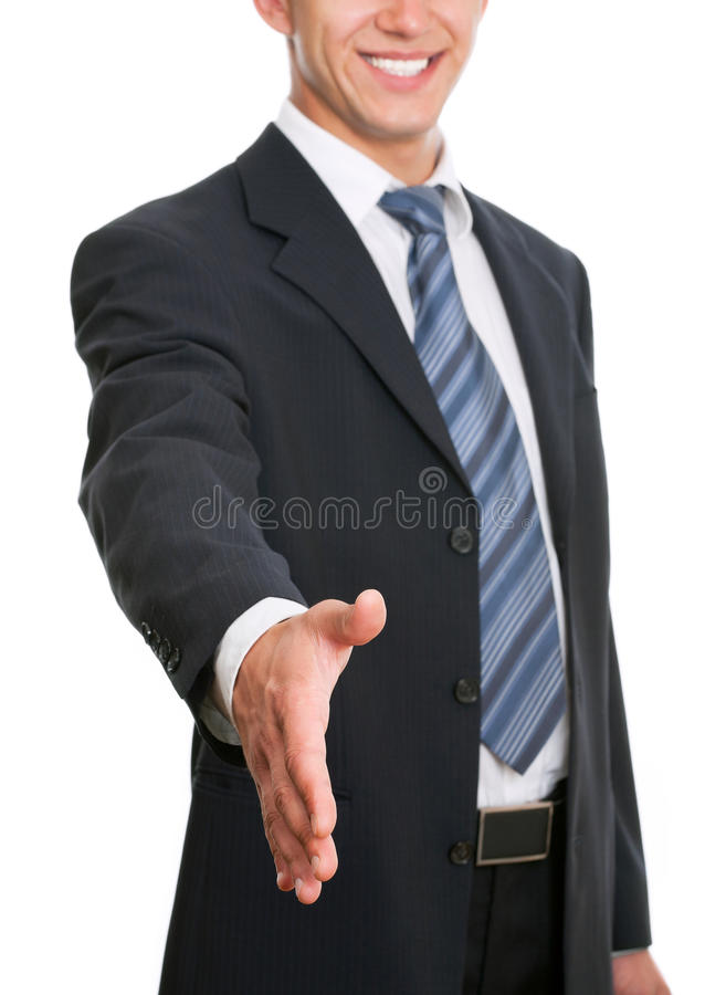 Businessman. A business man with an open hand ready to seal a deal royalty free stock images