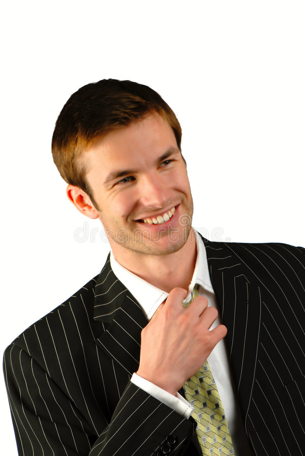 Businessman. Young businessman corrects for tie on white background royalty free stock photos