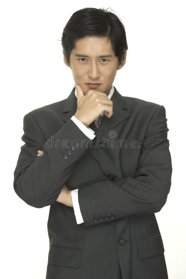 Businessman 8. A smart and smooth asian businessman in a grey suit with white shirt and pink tie stock photos