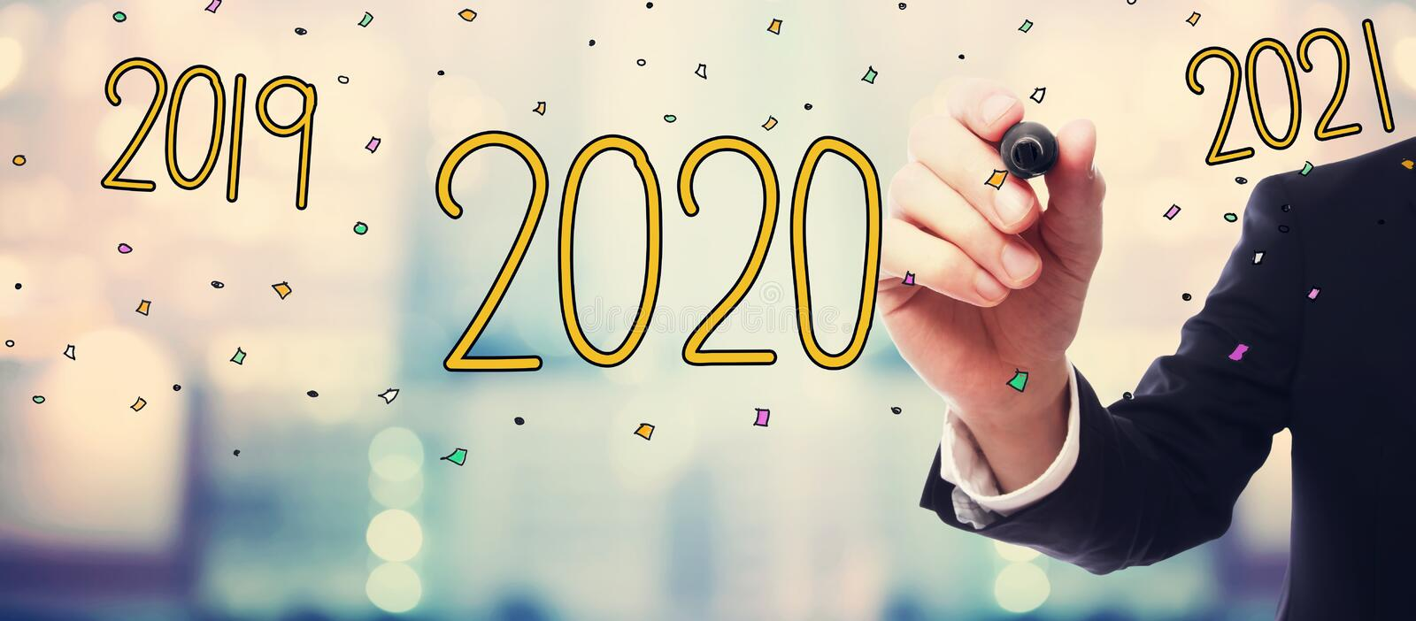 2020 with businessman on abstract background. 2020 concept with businessman on blurred abstract background stock photos