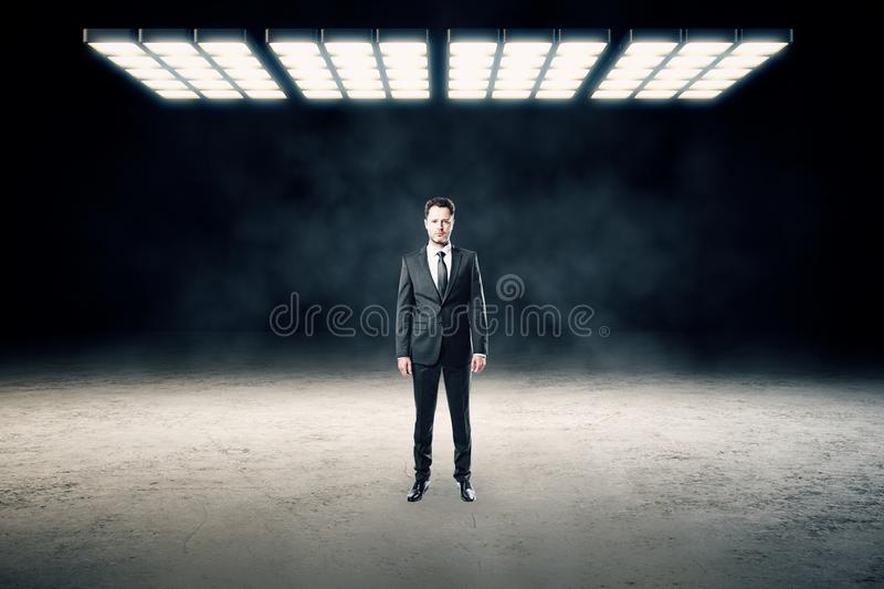 Businessman in abstract interior royalty free stock photo