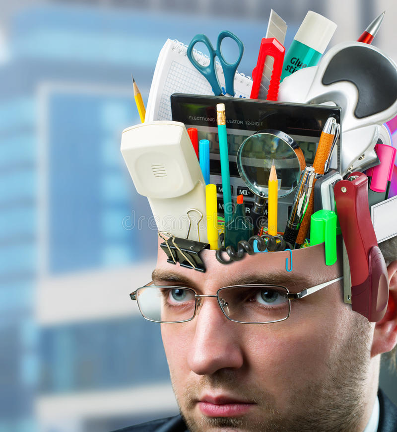 Businessman with accessories in head royalty free stock photo
