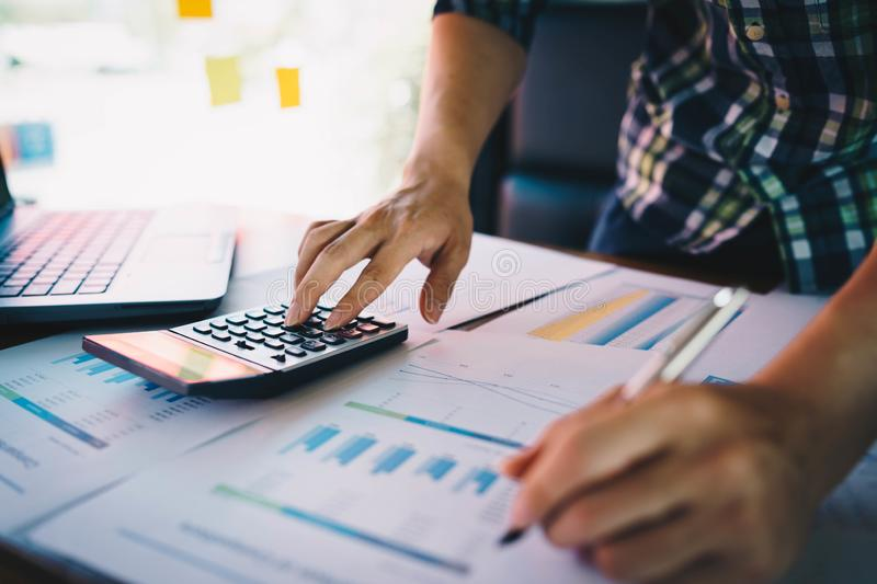 Businessman or accountant on desk in office using calculator to calculate budget. concept finance and accounting royalty free stock images