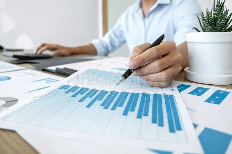 Businessman accountant making working audit and calculating expense financial annual financial report balance sheet statement, do. Ing finance making notes on royalty free stock photos