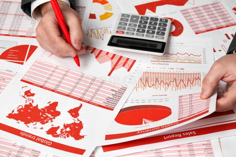 Businessman accountant using calculator for calculating cryptocurrency report on desk office. Business financial accounting stock image