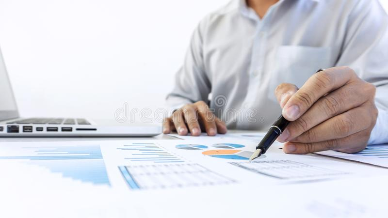 Businessman accountant working audit and calculating expense fin stock photos