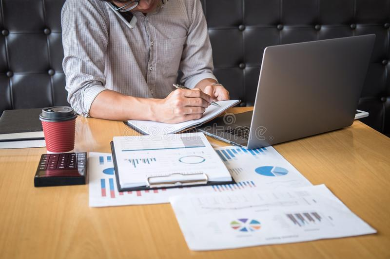 Businessman accountant working audit and calculating expense financial annual financial report balance sheet statement, doing stock photo