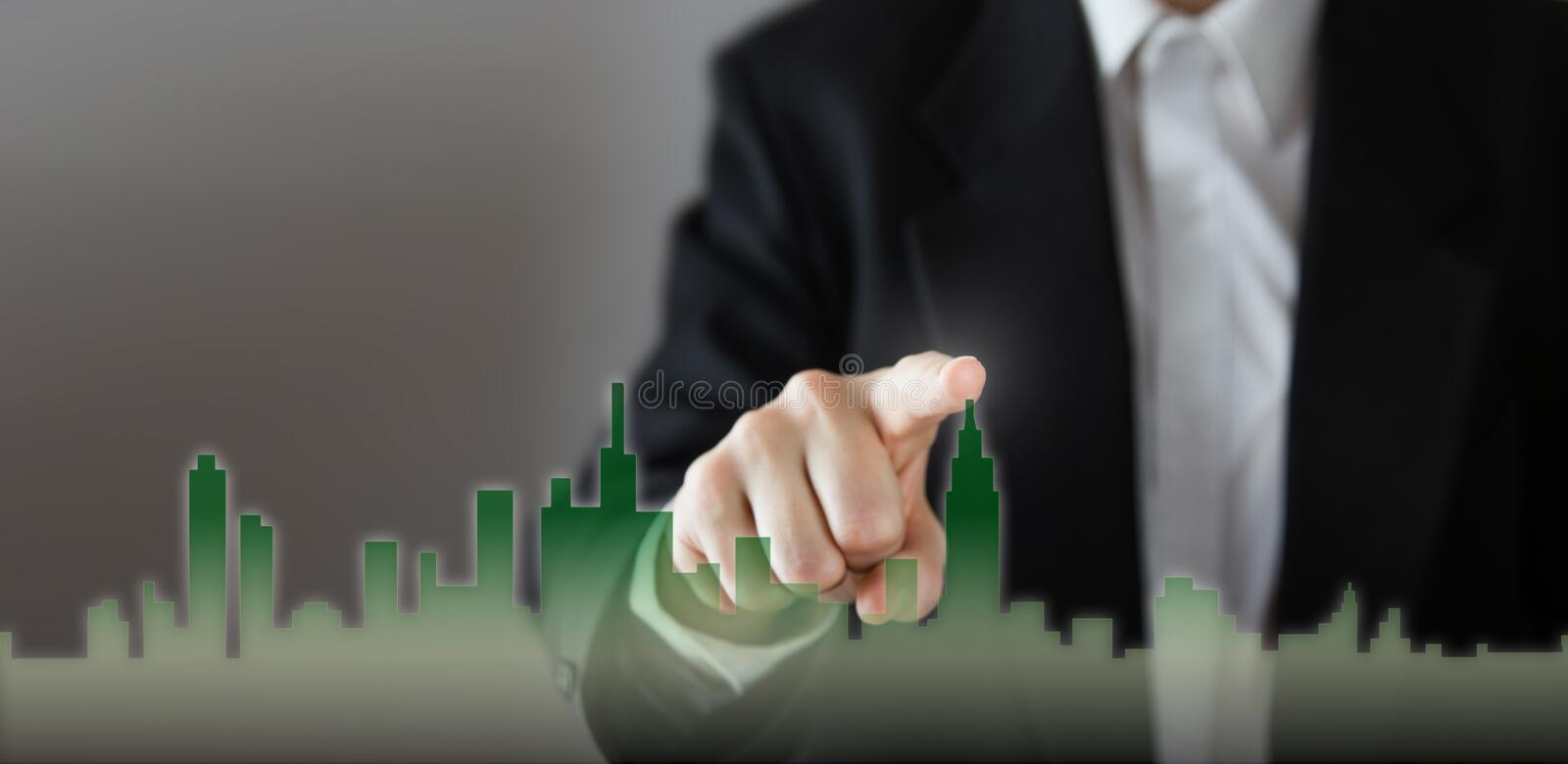Businessman Activate Growth Process, choosing house, real estate city concept. Skyline Hand pressing the house icon on. Virtual screen. Business, technology royalty free stock images