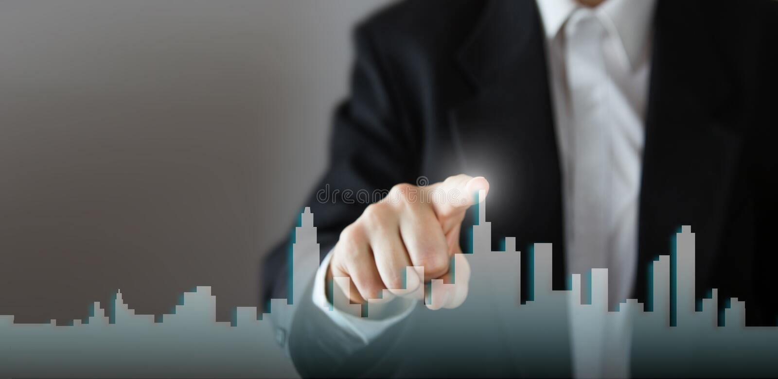 Businessman Activate Growth Process, choosing house, real estate city concept. Skyline Hand pressing the house icon on. Virtual screen. Business, technology royalty free stock photography
