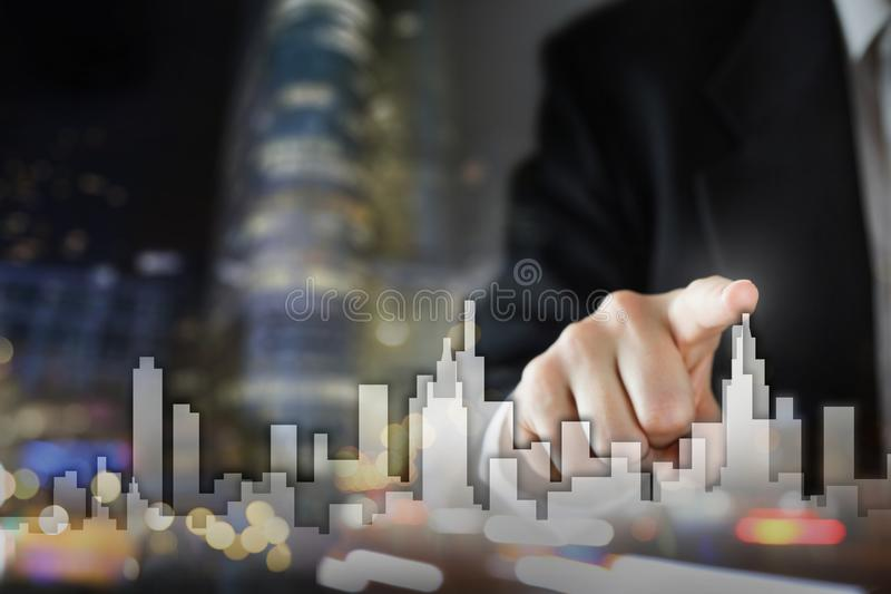 Businessman Activate Growth Process, choosing house, real estate city concept. Skyline Hand pressing the house icon on. Businessman Activate Growth Process stock photo