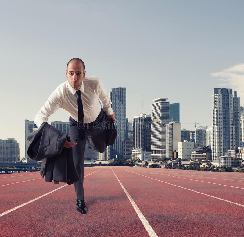 Businessman acts like a runner. Competition and challenge in business concept stock photos