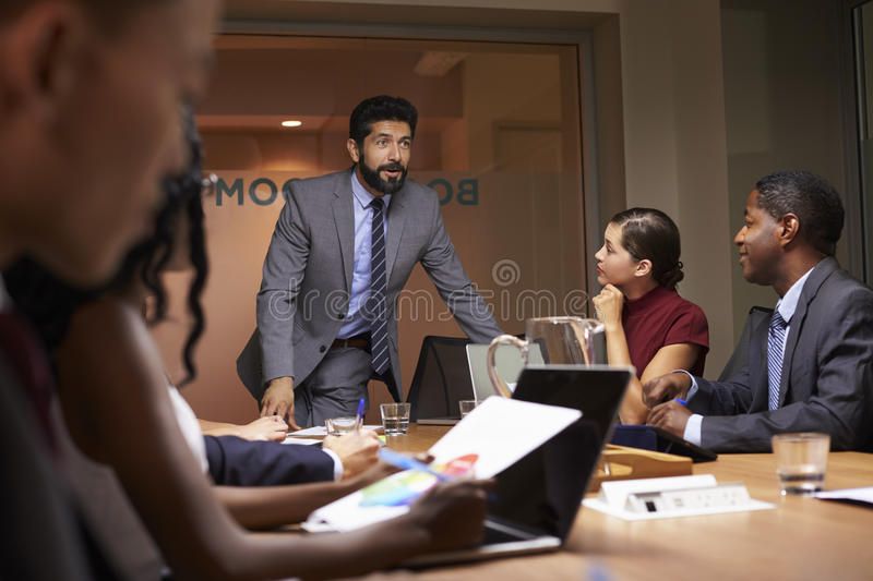 Businessman addressing team at a boardroom meeting, close up royalty free stock photo