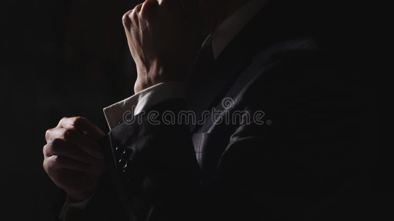 Businessman adjust cuff stock images