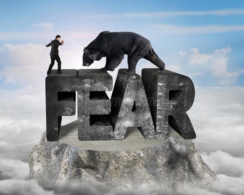 Businessman against black bear standing on fear 3D concrete word. Businessman against black bear standing on fear 3D mottled concrete word, on top of mountain stock images