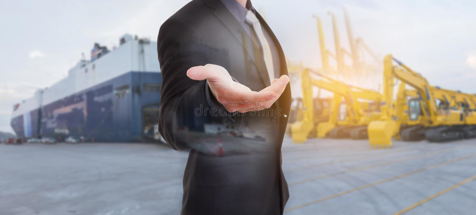 Businessman against logistics Import Export Tracts vehicle. At harbor background with business chance concept royalty free stock photo