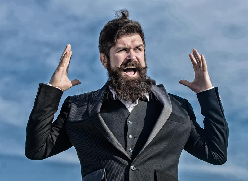 Businessman against the sky. Bearded man touch beard. Man with beard outdoor. brutal caucasian hipster with moustache royalty free stock photo