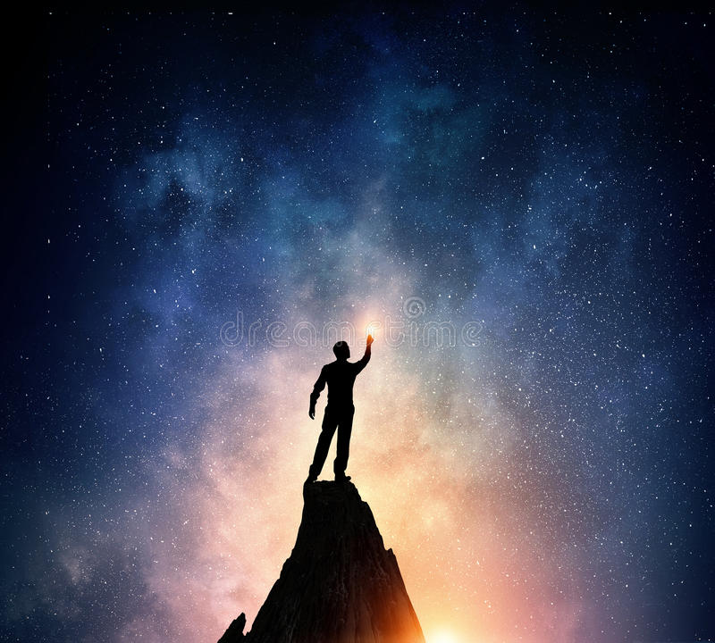 Businessman against starry sky . Mixed media stock image