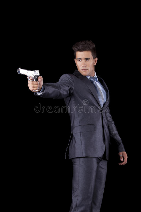 Businessman Aiming A Handgun Royalty Free Stock Photo