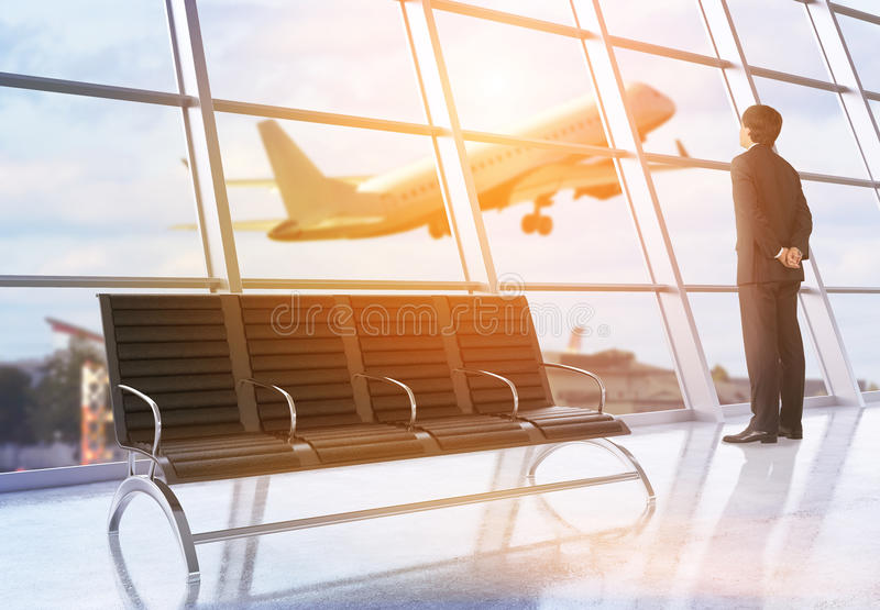 Businessman in airport stock image