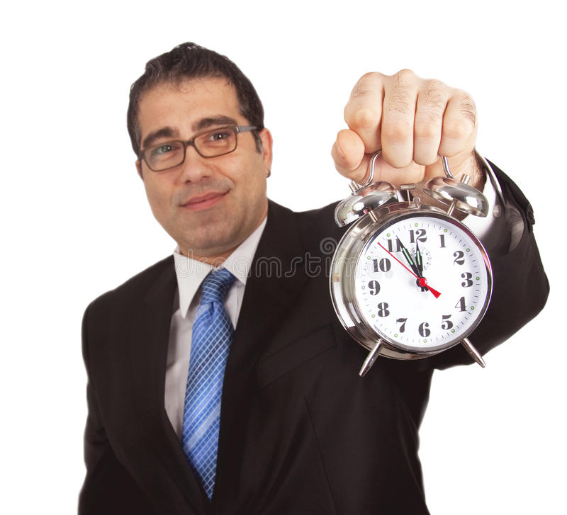 Businessman with alarm clock royalty free stock photography