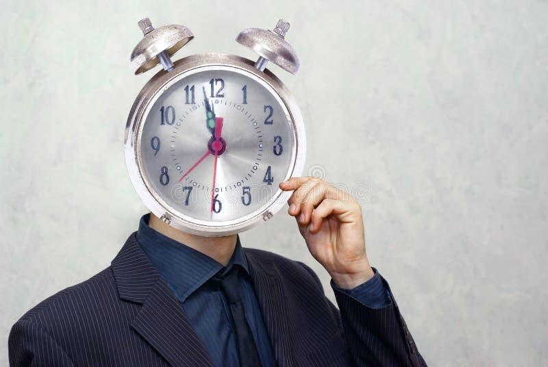 Businessman with alarm clock head royalty free stock photos